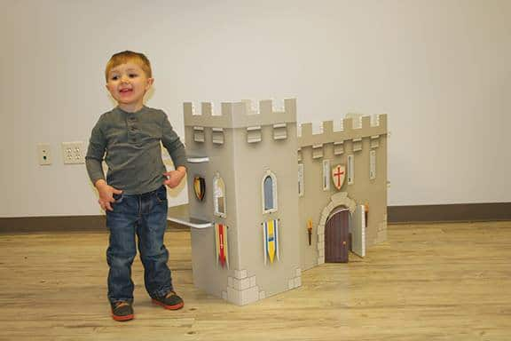 FunDeco Playhouses, boy next to castle