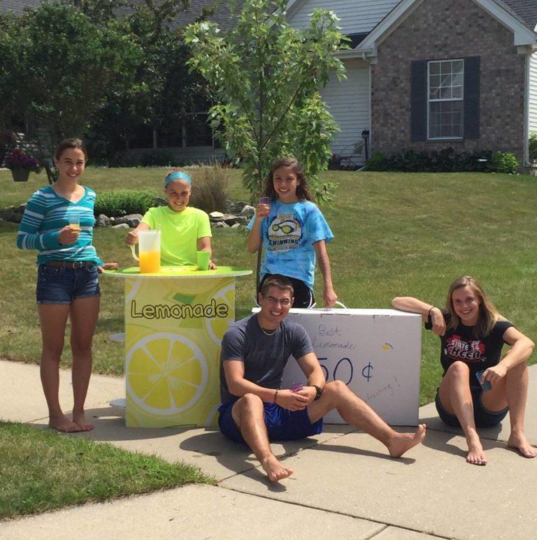 Kids outside on sidewalk using FunDeco Lemonade Stand
